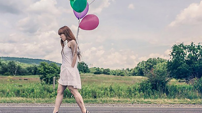 1409842058-where-find-best-stock-images-woman-balloons-1